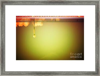 Lamp And Clouds In A Swimming Pool Framed Print by Silvia Ganora
