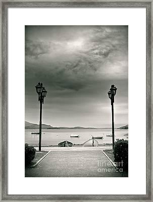 Lamps On Lake Framed Print by Silvia Ganora