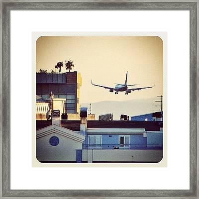 Landing Above Buildings Framed Print