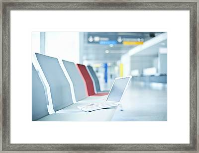 Laptop On Chairs In Airport Waiting Area Framed Print by Cultura/Luc Beziat