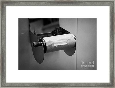 Last Remaining Sheet Of Toilet Paper On A Toilet Roll Holder Framed Print by Joe Fox
