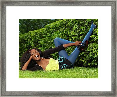Laughing Young Woman Lying On The Grass Framed Print by Oleksiy Maksymenko