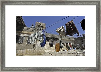 Laundry Hangs In The Courtyard Framed Print