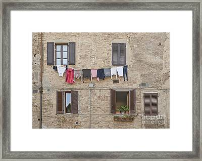 Laundry Out To Dry Framed Print by Rob Tilley