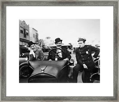 Laurel And Hardy, 1928 Framed Print by Granger