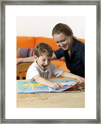 Learning To Read Framed Print by Tek Image