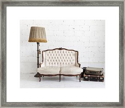 Leather Sofa In White Room Framed Print