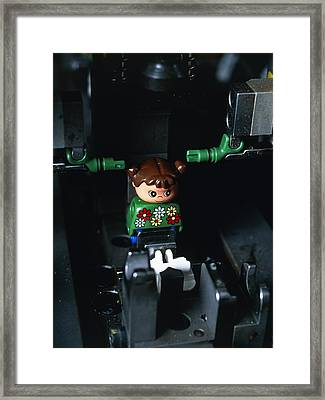 Lego Doll In An Assembly Machine Framed Print