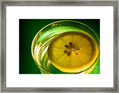 Lemon In The Glass Of Water Framed Print