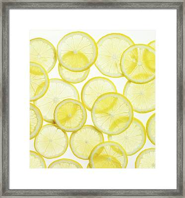 Lemon Slices Arranged In Pattern Framed Print by Lauren Burke