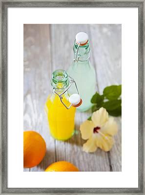 Lemonade And Orangeade In Swing Top Bottles Framed Print by Pam McLean