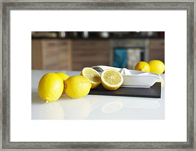 Lemons And Juicer On Kitchen Counter Framed Print by Debby Lewis-Harrison
