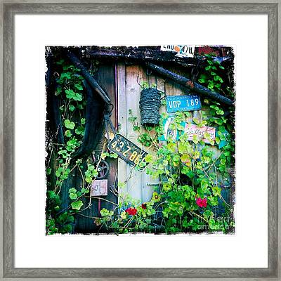 Framed Print featuring the photograph License Plate Wall by Nina Prommer