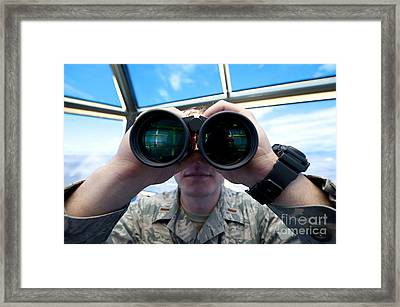 Lieutenant Uses Binoculars To Scan Framed Print by Stocktrek Images