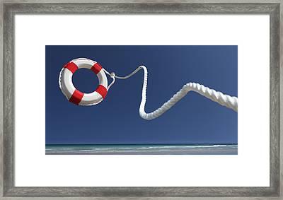 Lifering In Air On Beach Framed Print