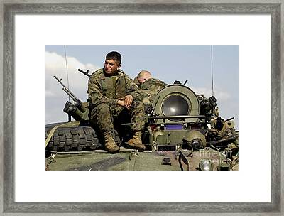 Light Armor Vehicle Crew Member Waits Framed Print by Stocktrek Images