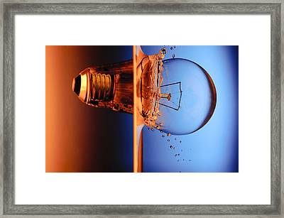 Light Bulb Shot Into Water Framed Print by Setsiri Silapasuwanchai