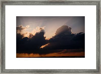 Light Rays And Rainy Skies Framed Print by Aaron Burrows