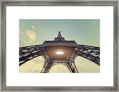Light Shining Through Eiffel Tower Framed Print