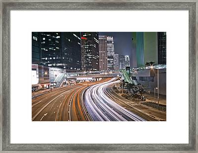 Light Trails On Road Framed Print by Andi Andreas