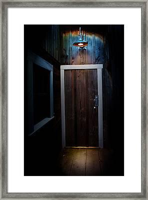 Lighted Doorway Framed Print by Raymond Potts