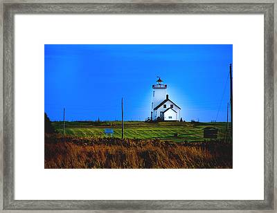 Lighthouse In Darkness Framed Print