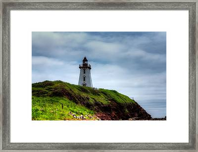 Lighthouse On A Cliff Framed Print by Matt Dobson