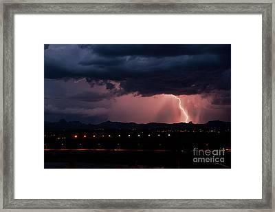 Lightning Strike Framed Print by Eddie Yerkish