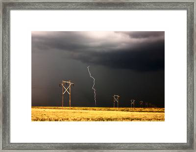Lightning Striking Behind Saskatchewan Power Line Framed Print by Mark Duffy