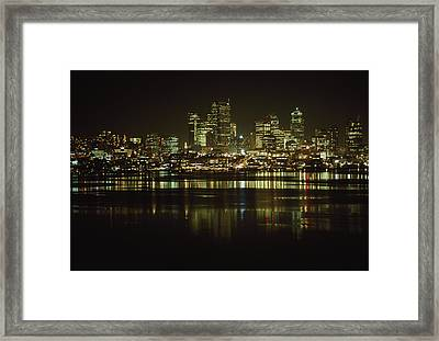 Lights Of Downtown Seattle Reflect Framed Print by Gordon Wiltsie