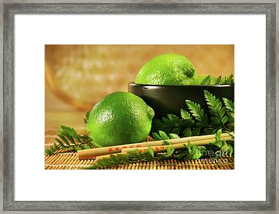Limes With Chopsticks Framed Print by Sandra Cunningham