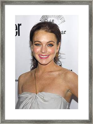 Lindsay Lohan Wearing Chanel Earrings Framed Print by Everett