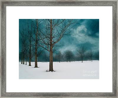 Line Of Trees Border A Snowy Field With A Rising Moon In A Cloudy Sky.  Framed Print