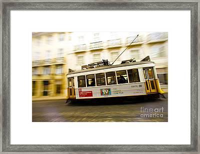 Lisbon Tram Framed Print by Andre Poling