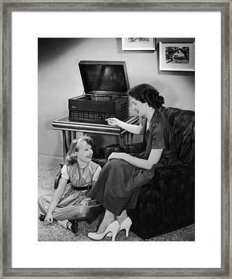 Listen With Mother Framed Print by Archive Photos