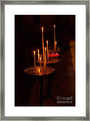 Lit Candles In A Church Framed Print by Louise Heusinkveld
