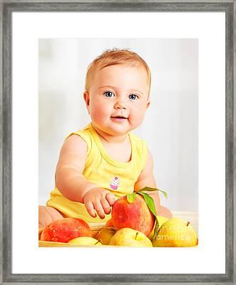 Little Baby Choosing Fruits Framed Print by Anna Om