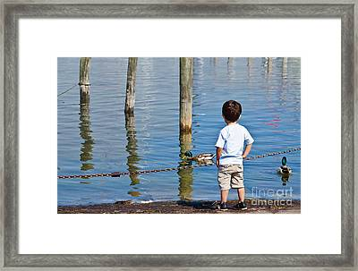 Little Boy By The Water Framed Print