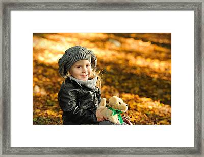 Little Girl In Autumn Leaves Framed Print