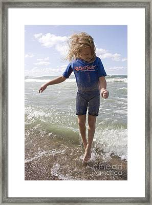 Little Girl Jumping In The Surf In Lake Michigan Framed Print by Christopher Purcell