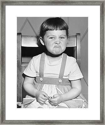 Little Girl Making A Face Framed Print by George Marks