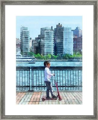Little Girl On Scooter By Manhattan Skyline Framed Print by Susan Savad