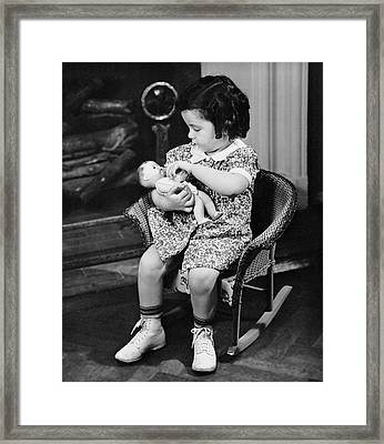 Little Girl Playing With Doll Framed Print by George Marks