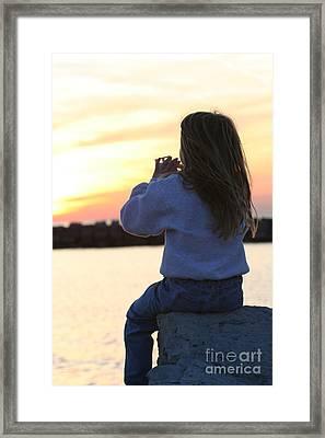 Little Girl Sitting On Rocks Framed Print by Christopher Purcell