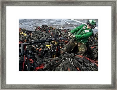 Logistics Specialist Wraps Cargo Nets Framed Print by Stocktrek Images
