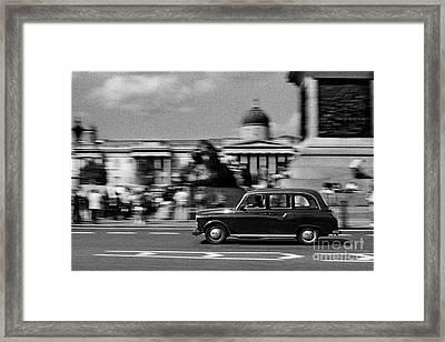 London Cab In Trafalgar Square Framed Print by Aldo Cervato