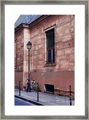 Framed Print featuring the photograph Lone Bike by Kim Wilson