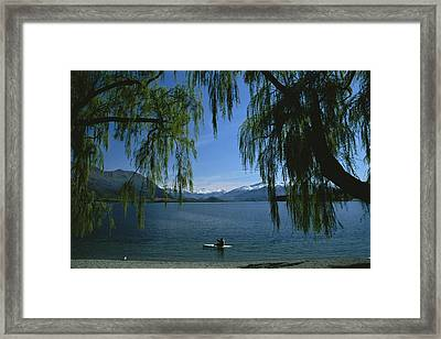 Lone Kayaker On A Lake With Snow-capped Framed Print