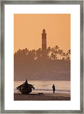 Lone Person Walking Along Lighthouse Beach In Early Morning Framed Print by Anders Blomqvist