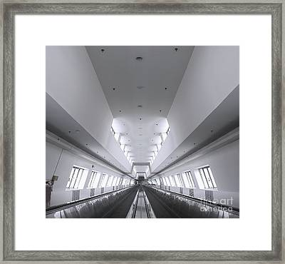 Long Walkway With Escalators Framed Print